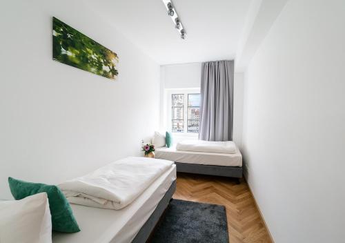 Ein Bett oder Betten in einem Zimmer der Unterkunft Aparthotel Am Schloss