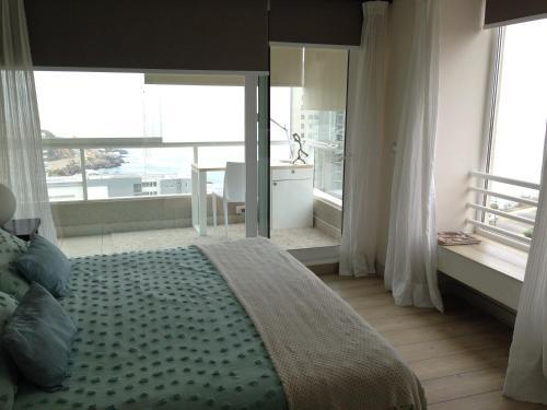 A bed or beds in a room at Apartamento Vistamar Concon