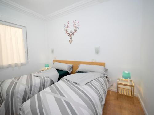 Ein Bett oder Betten in einem Zimmer der Unterkunft Elegante piso en calle Goya