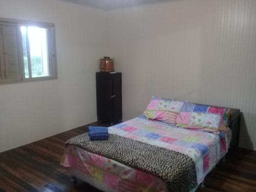 A bed or beds in a room at Casa Familiar