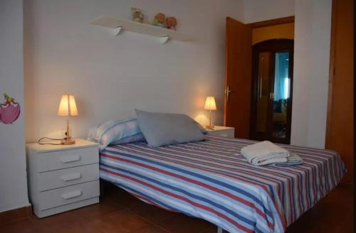 A bed or beds in a room at Sleeping in Valencia Torrente