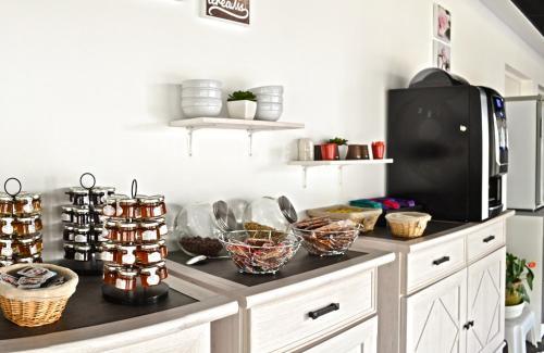 A kitchen or kitchenette at Résidence Azurea