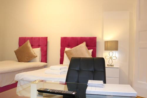 A bed or beds in a room at Angel Apartments - Islington
