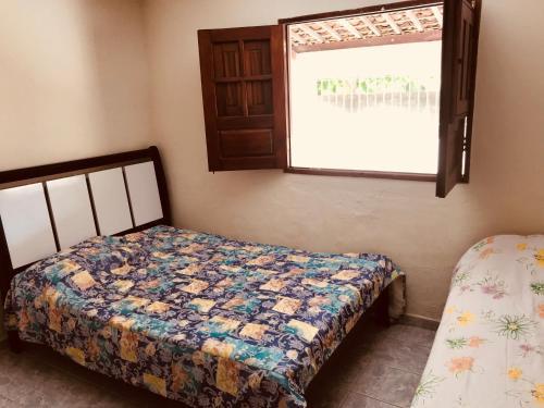 Kama o mga kama sa kuwarto sa Casa Em Praia Azul
