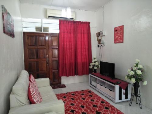 Ruang duduk di SUFIZA Residence