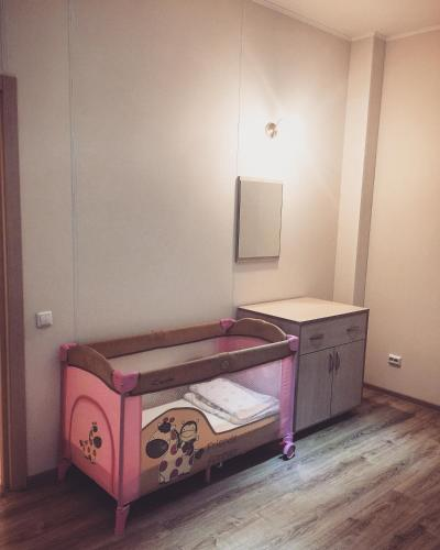 A bed or beds in a room at Lida Mini-hotel