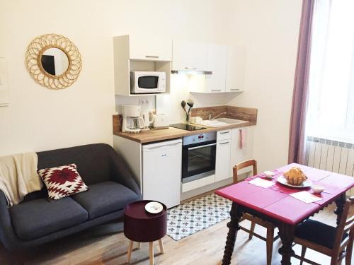 Cuisine ou kitchenette dans l'établissement Maison Fournier