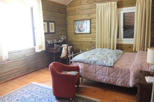 A bed or beds in a room at Chalet Paola