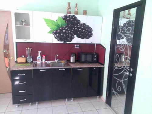 A kitchen or kitchenette at Letnyaya Dacha