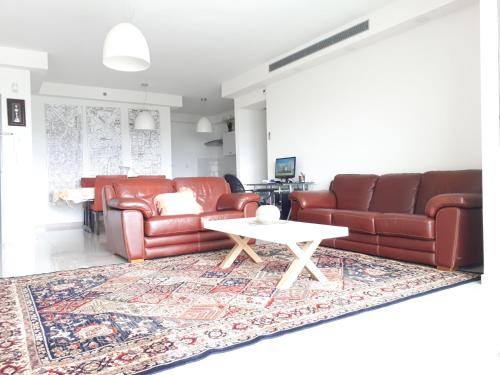 A seating area at Apartment in the center Ashdod