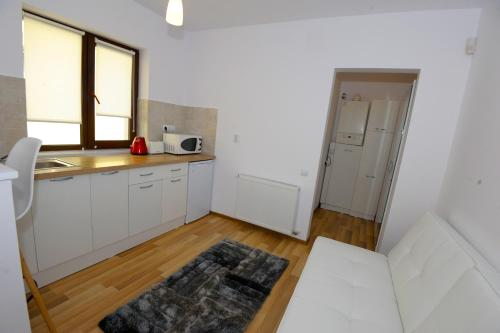 A kitchen or kitchenette at Yael Luxury Apartments 1