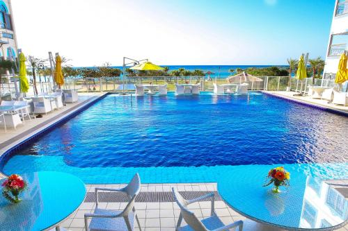 The swimming pool at or near Beachside Condominium