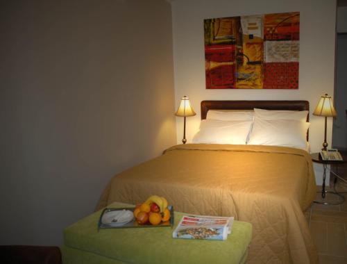 Ένα ή περισσότερα κρεβάτια σε δωμάτιο στο Aria Hotel Samos Town