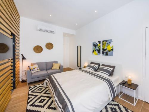 A bed or beds in a room at Apartments Withlove Zadar