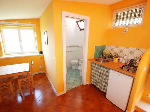 A kitchen or kitchenette at Locazione turistica Enchanting View
