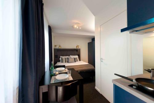 Télévision ou salle de divertissement dans l'établissement Stockholm Hotel Apartments Bromma