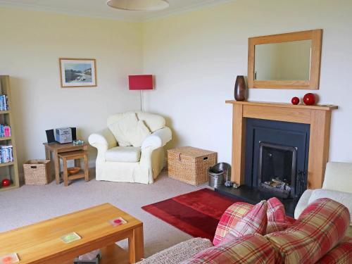 A seating area at Holiday Home Teangue