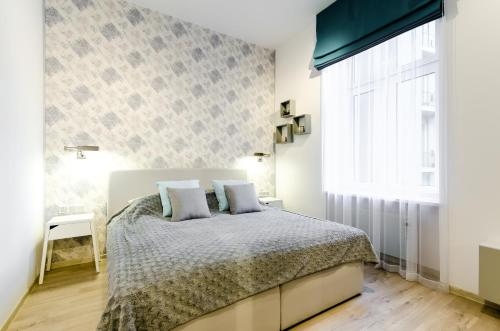 Lova arba lovos apgyvendinimo įstaigoje Central Krak Apartments