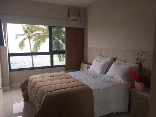 A bed or beds in a room at Ondina Apart Hotel