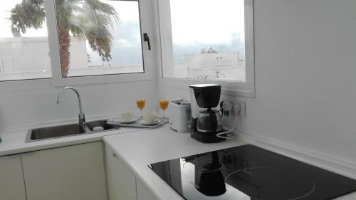 Кухня или мини-кухня в Apartamento Calero