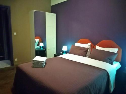 Un ou plusieurs lits dans un hébergement de l'établissement Apartments AMS Brussels Flats