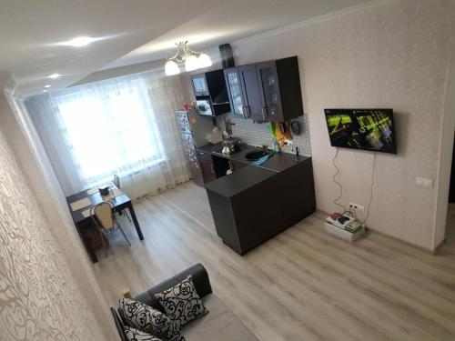 A television and/or entertainment center at Аpartment Borisovka