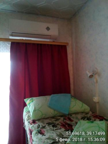 Кровать или кровати в номере Voronezh Dom 42 k 3 arenda koikomesta