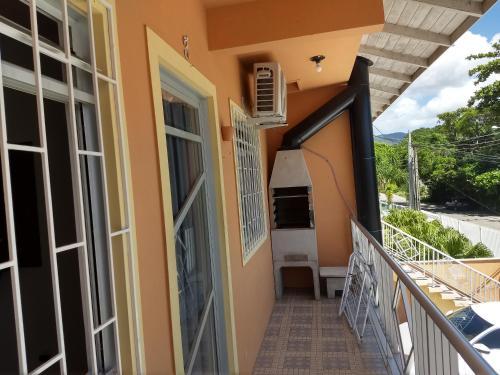 Un balcón o terraza de Residencial Mizinho