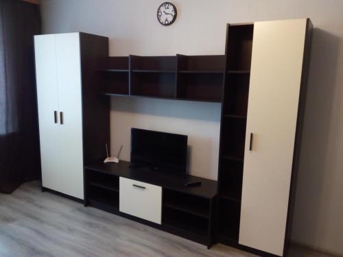 Телевизор и/или развлекательный центр в Apartment on Sovetskaya 21