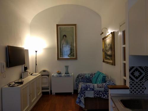 Uma área de estar em San Vito Apartment