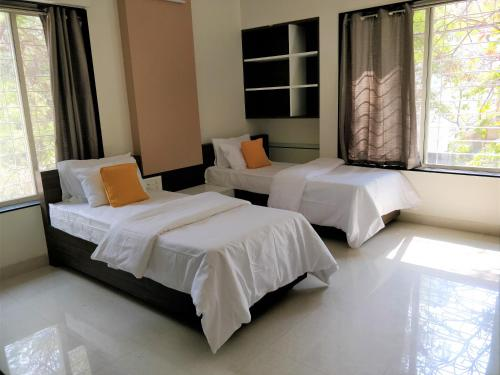 A bed or beds in a room at Bauhinia