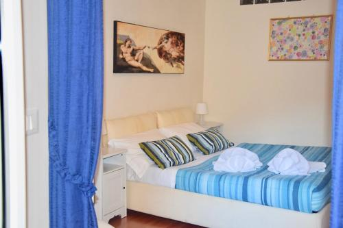 A bed or beds in a room at Cuore di Roma Apartment