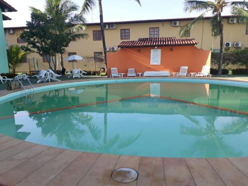 The swimming pool at or near Apartamento Taperapuã Village