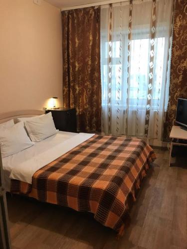 Кровать или кровати в номере Хостел на Петровского