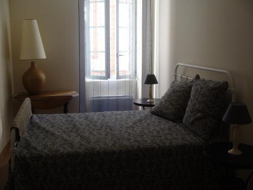 Cama o camas de una habitación en Le Mazérien