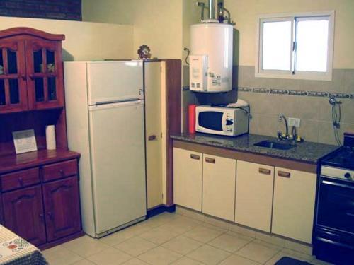Una cocina o kitchenette en Cabañas Don Pancho