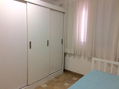Cama o camas de una habitación en Edifício Afonso Delambert