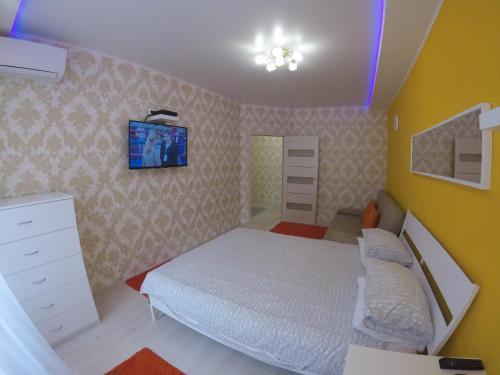 Кровать или кровати в номере New Stadium Krasnodar Apartment