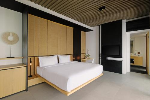 A bed or beds in a room at Origin Ubud