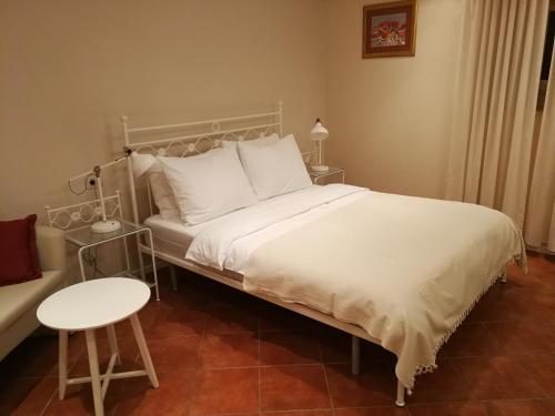 A bed or beds in a room at Apartments Nivic
