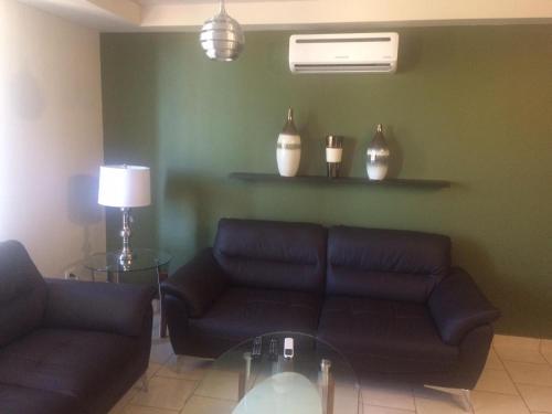 A seating area at Ecovivienda Apartment