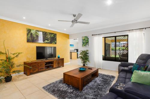 A seating area at Private Large Cairns Family Home, Rainforest Views