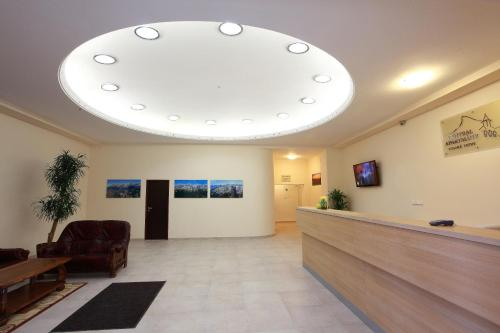 The lobby or reception area at Central Apartmany