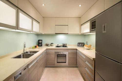 A kitchen or kitchenette at Oakwood Residence Hangzhou