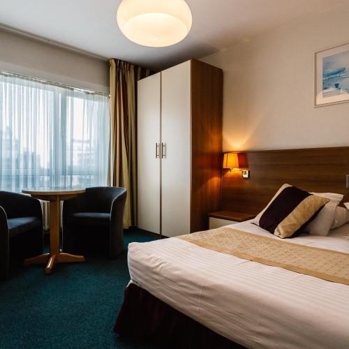 Un ou plusieurs lits dans un hébergement de l'établissement Hotel Prado
