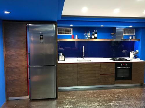 A kitchen or kitchenette at Joan Apartments & Spa