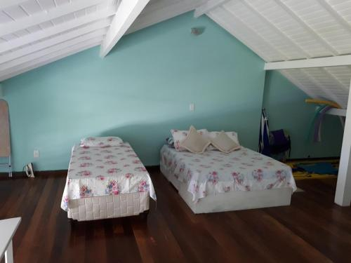 A bed or beds in a room at Angra Apartament