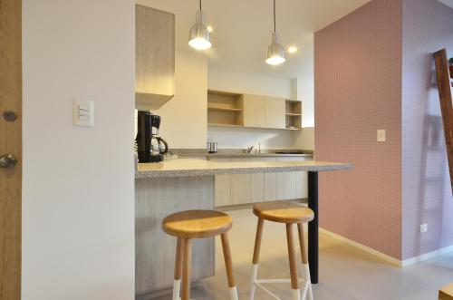 A kitchen or kitchenette at Manila House