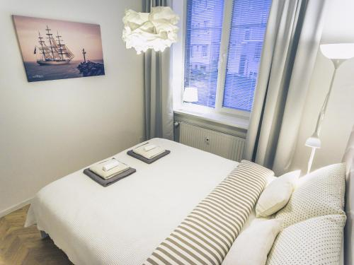 A bed or beds in a room at No.3 Apartment Link-To-Happiness