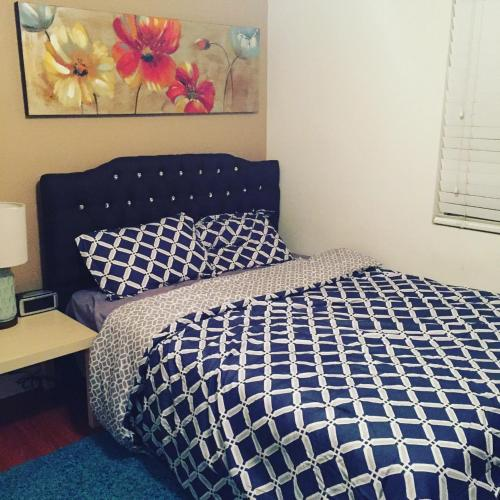 A bed or beds in a room at Clean and Nice Single Room